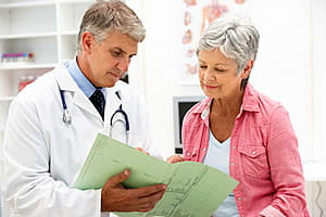 Doctor showing information to a patient