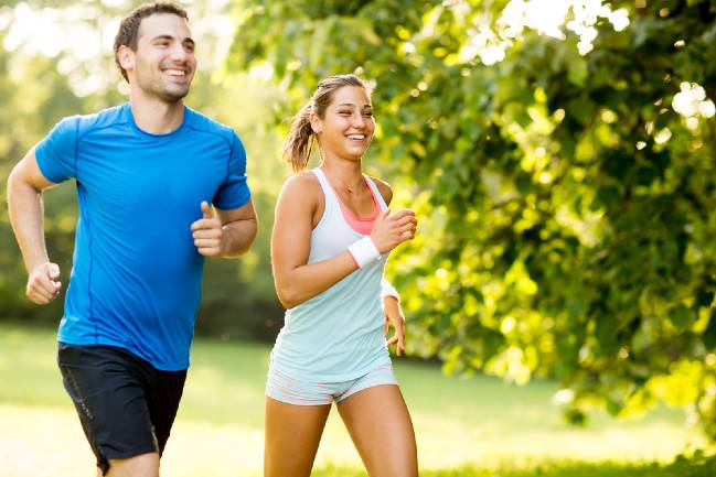 Smiling couple jogging.