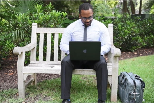 Patient having an E-Visit on his computer in the park