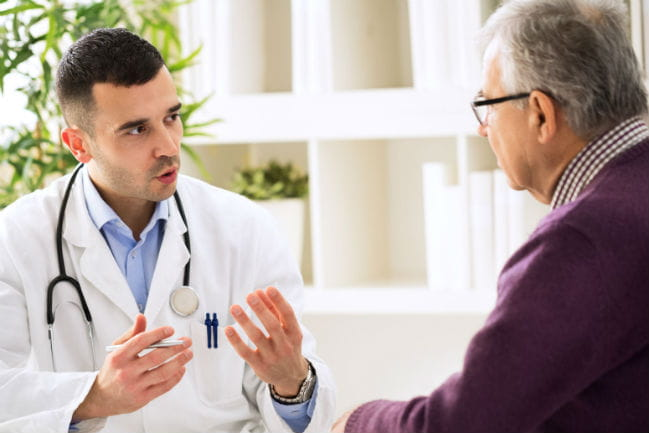 Image of patient and caregiver having conversation.