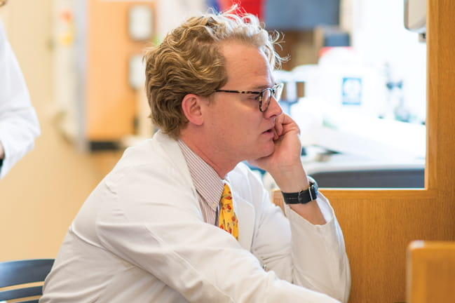 Medical oncologist Dr. John Wrangle leads trials of novel precision and immune-based therapeutics.