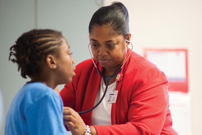 Dr Sherron M. Jackson examines a sickle cell patient
