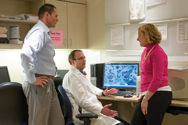 Dr. Lewis Cooper discusses a case with Dr. Jennifer Young Pierce and physics team member Christopher Mart.