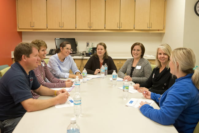 A meeting of a pediatric patient family advisory council