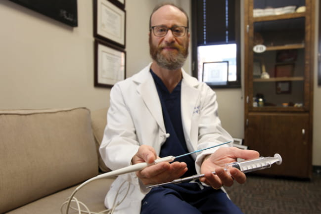 Bruce Frankel, M.D., holds a smart instrument
