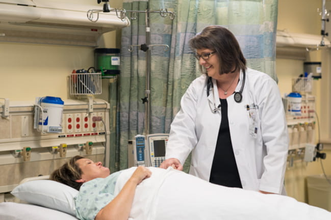 Chief Medical Officer, Tallulah Holmstrom, M.D., with patient in the KershawHealth ICU