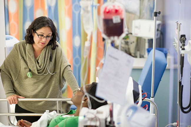 Julie Kanter, M.D., listens to a patient in MUSC's nationally-ranked hospital.