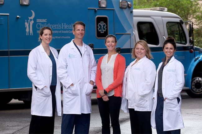 Five members of the pediatric trauma team pictured in front of MUSC Children's Health