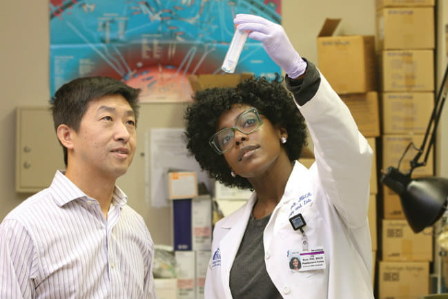 Image of Dr. Hongkuan Fan on the left and Dr. Joy Jones Buie on the right.