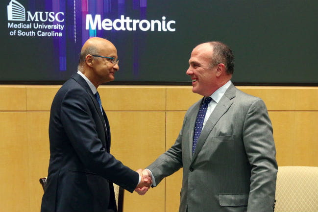 Omar Ishrak, Ph.D., Chairman and CEO of Medtronic (left), and Patrick Cawley, M.D., CEO of MUSC Health and Vice President for Health Affairs of the Medical University of South Caro-lina (right).