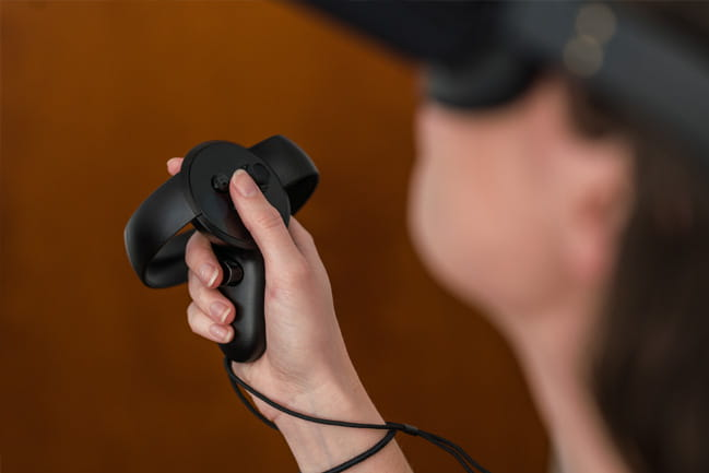 person holding virtual reality controller