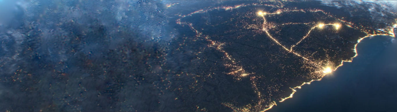 Decorative image of an artists rendering of South Carolina as seen from space at night.