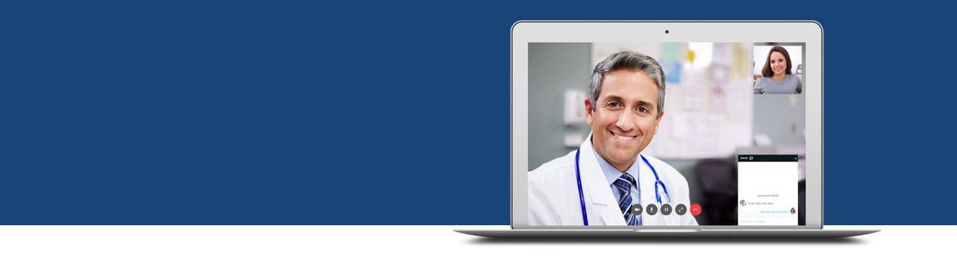 smiling provider and patient tele communicating via computer