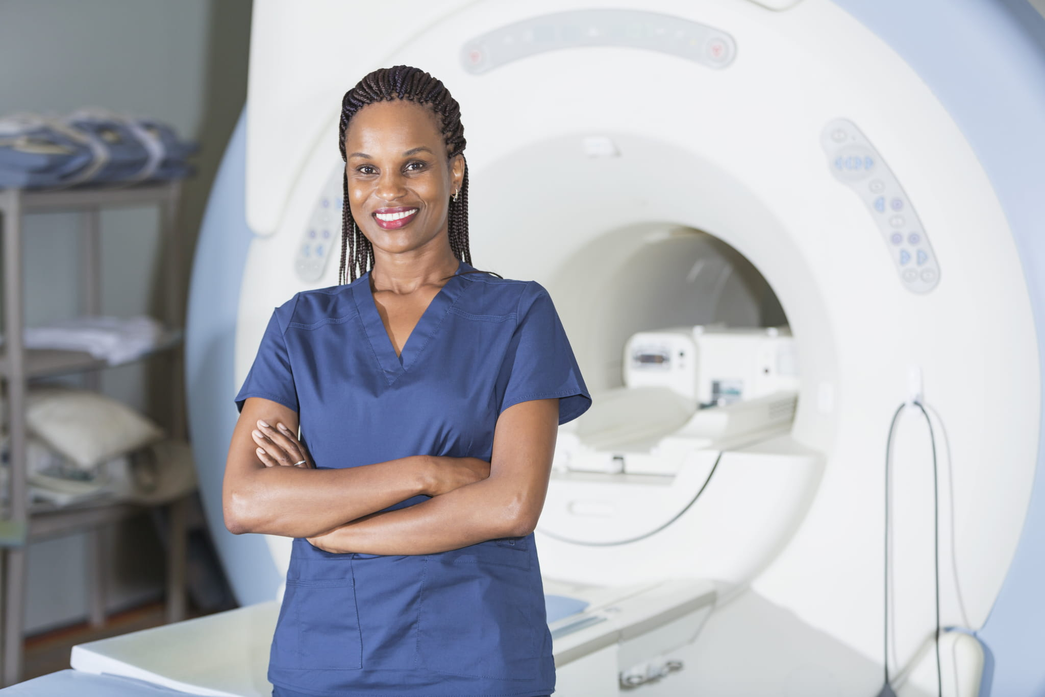 woman in scrubs with MRI machine