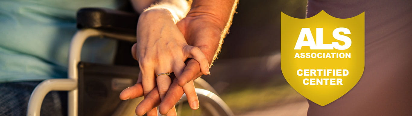Image of two people holding hands with a badge that reads ALS Association Certified Center