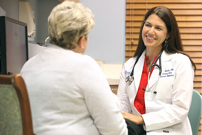 Dr. Erika Strand consults with a patient