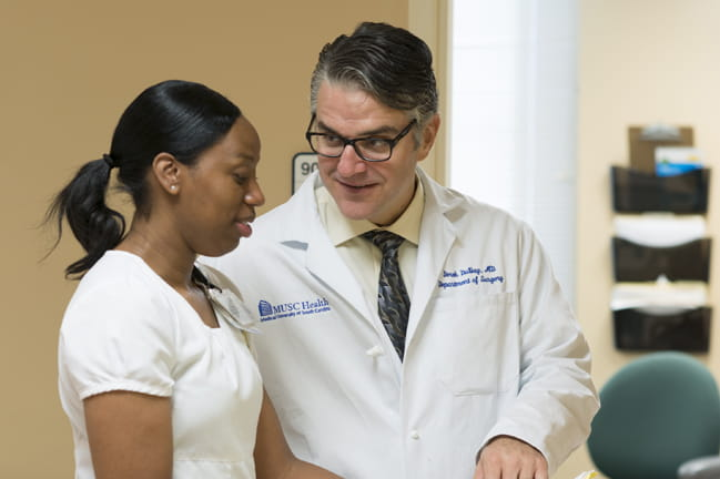 Liver transplant surgeon Dr. Derek DuBay with a colleague.