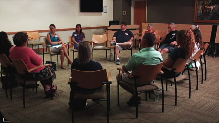 Patients sitting in circle at support group