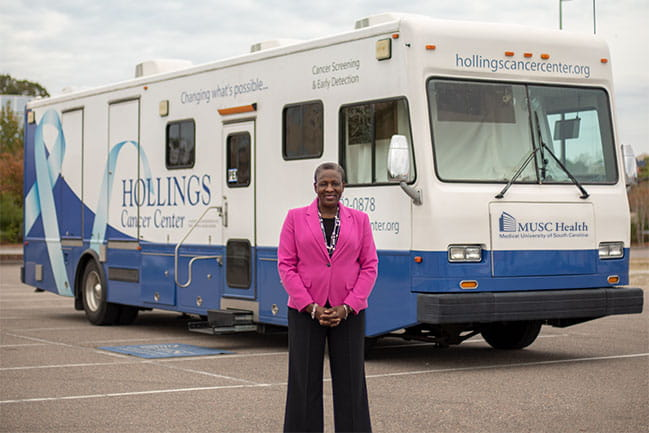 Melanie Slan next to the mobile health unit