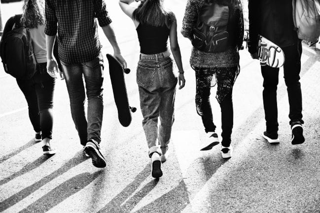 Image of five teenagers walking