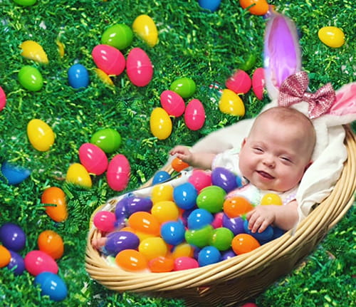 Adorable photo of baby girl in a basket posed so large Easter bunny ears appear to be atop her head, with her whole body covered in plastic colored Easter eggs