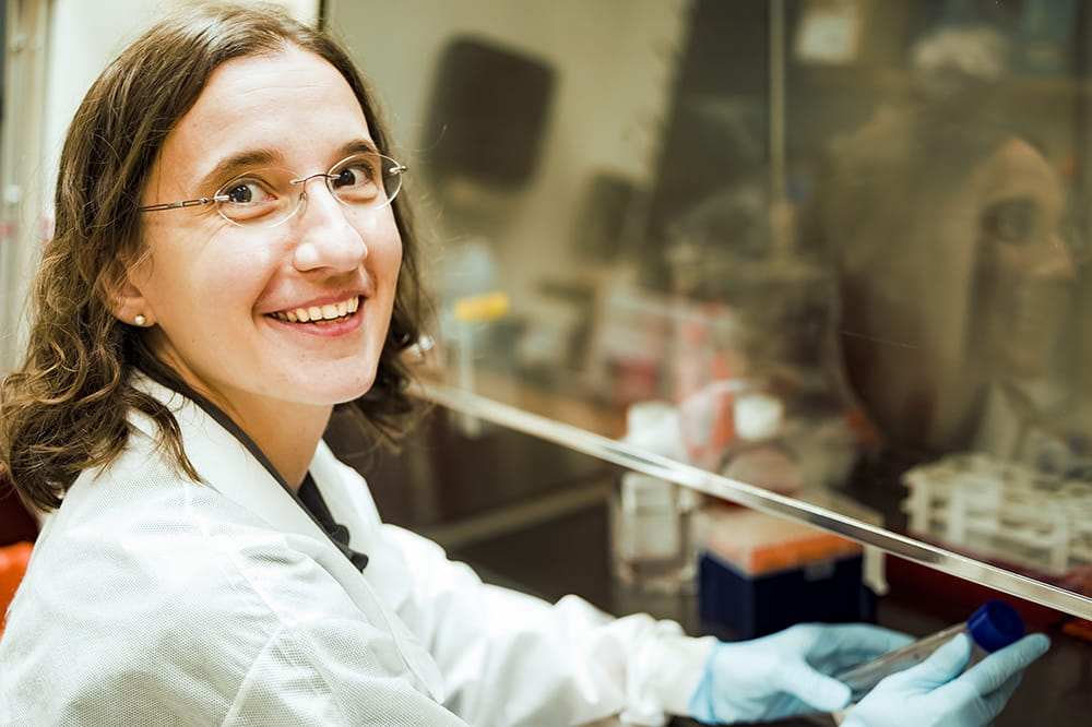 Mariana Pehar smiles in her lab