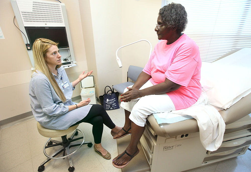 Gynecologist Autumn Edenfield talks with Mary Lee Cromer