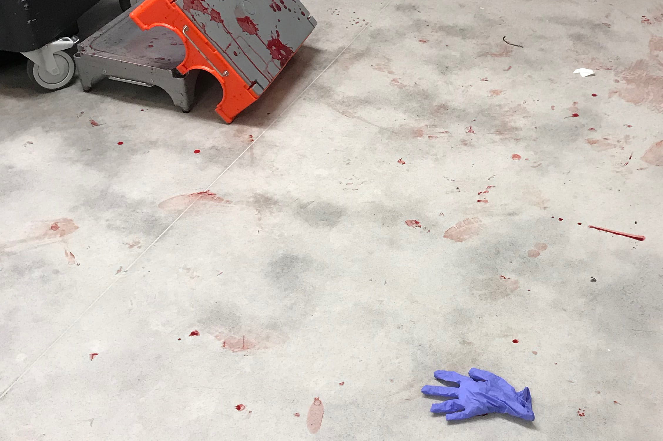 A lone latex glove on floor of OR