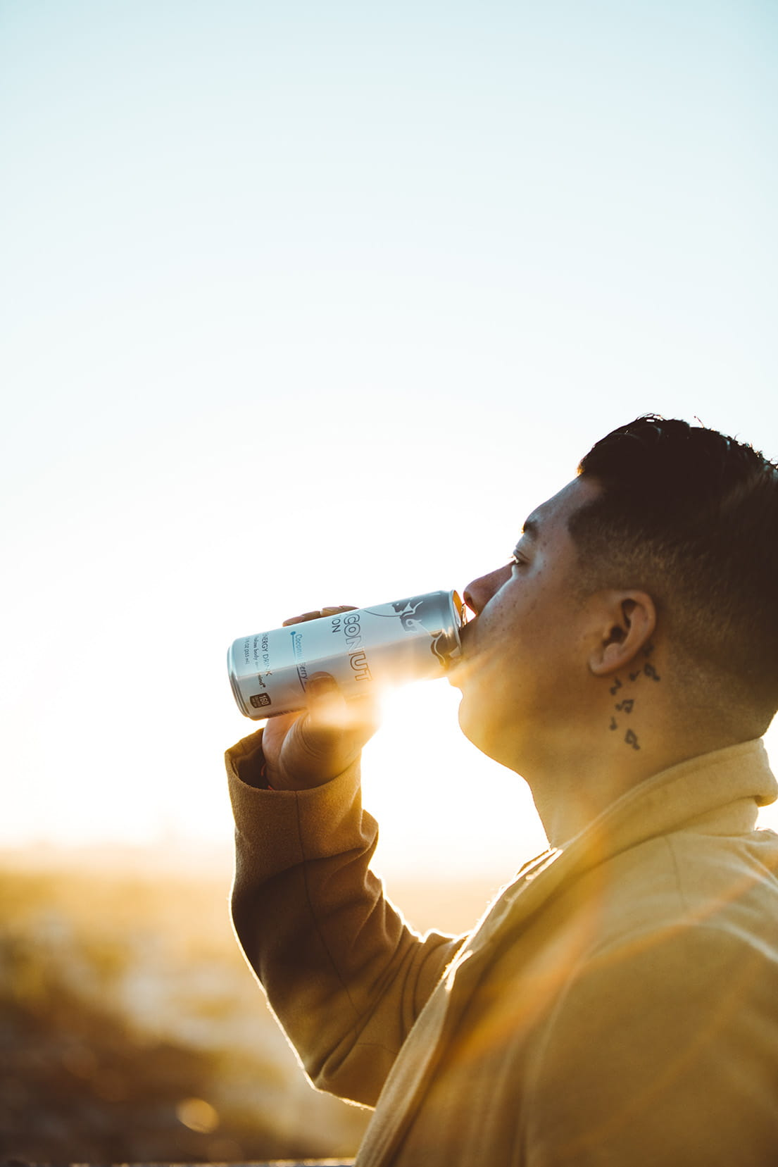 man drinking an energy drink