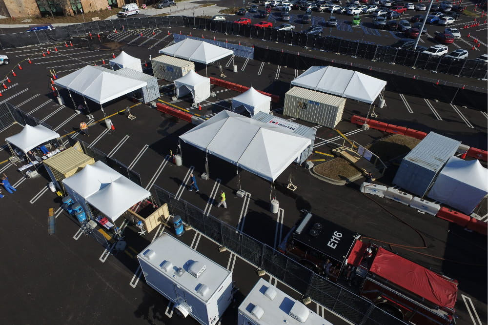 an aerial shot showing the tents set up in the mall parking lot for the drive through specimen collection site.